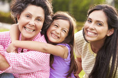 Grandmother With Granddaughter And Mother In Park Stock Photography