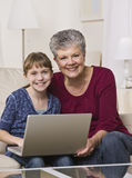 Grandmother and Granddaughter Online royalty free stock photo