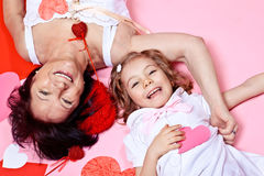 Grandmother and granddaughter with paper hearts Royalty Free Stock Images