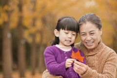 Grandmother and granddaughter in park Royalty Free Stock Photography