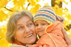 Grandmother with granddaughter in park Stock Images