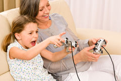 Grandmother and granddaughter play computer game Stock Photo
