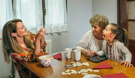 Grandmother and granddaughter play a game on the tablet Royalty Free Stock Photography