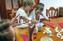 Grandmother and granddaughter play a game on the tablet Stock Photography