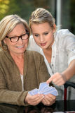 Grandmother and granddaughter playing cards Stock Photography