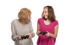 Grandmother and granddaughter playing game Stock Photo