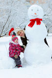 Grandmother with granddaughter playing in snow Stock Images
