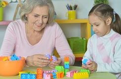 Grandmother with granddaughter playing together Royalty Free Stock Photos