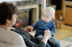 Grandmother and granddaughter playing together Royalty Free Stock Images