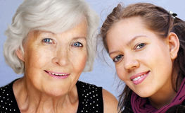 Grandmother and granddaughter portrait. Grandmother and granddaughter looking at camera together,smiling Royalty Free Stock Images