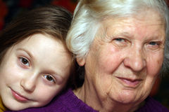 Grandmother and granddaughter. Portrait of a grandmother and granddaughter, close-up Royalty Free Stock Photography