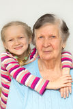 Grandmother and granddaughter. Portrait of a great-grandmother, great-granddaughter, close-up Stock Image
