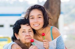 Grandmother and granddaughter posing happily Stock Image