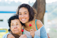 Grandmother and granddaughter posing happily Royalty Free Stock Image
