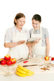 The grandmother and the granddaughter read the recipe-book Stock Photo