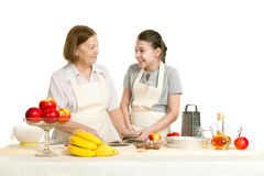 The grandmother and the granddaughter read the recipe-book. Before cooking of food and smile each other Royalty Free Stock Photography