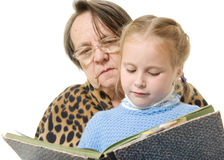 Grandmother granddaughter reading a book Royalty Free Stock Photography