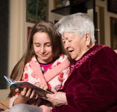 Grandmother and granddaughter reading a book Stock Image