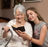 Grandmother and granddaughter reading a book Royalty Free Stock Image