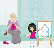 Grandmother and granddaughter relaxing at home Stock Photos