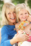 Grandmother And Granddaughter Relaxing Together. Grandmother And Granddaughter Relaxing On Sofa Together Royalty Free Stock Photo
