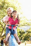 Grandmother And Granddaughter Riding On See Saw Royalty Free Stock Photography