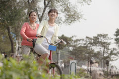 Grandmother and granddaughter riding tandem bicycle, Beijing Royalty Free Stock Image