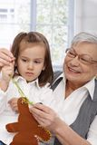 Grandmother and granddaughter sewing Royalty Free Stock Photo