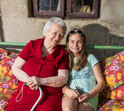 Grandmother and granddaughter sitting on the bench Stock Photography
