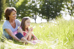 Grandmother And Granddaughter Sitting In Summer Field Royalty Free Stock Photos