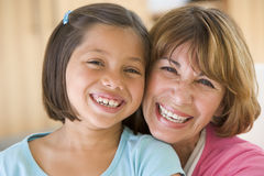 Grandmother and granddaughter smiling. Together Royalty Free Stock Image
