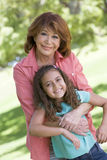 Grandmother and granddaughter smiling stock image