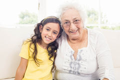 Grandmother and granddaughter smiling Royalty Free Stock Photos