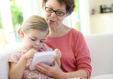Grandmother and granddaughter spending time together royalty free stock images