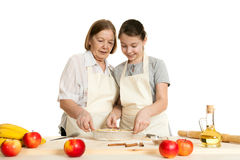 The grandmother and the granddaughter stack dough strips Stock Photo