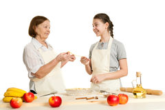 The grandmother and the granddaughter stack dough strips Royalty Free Stock Images