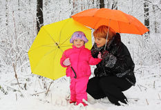 Grandmother and granddaughter stand in woods royalty free stock images