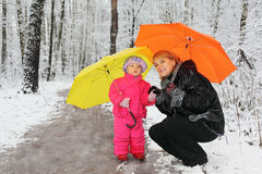 Grandmother and granddaughter stand in woods royalty free stock photos