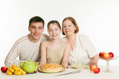 The grandmother and the granddaughter treat the father Royalty Free Stock Images
