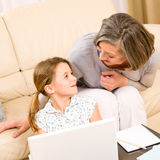 Grandmother with granddaughter use  computer Stock Photos
