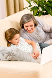 Grandmother with granddaughter use  computer Royalty Free Stock Photos