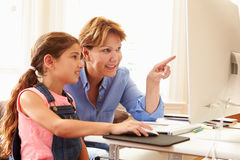 Grandmother And Granddaughter Using Computer At Home Stock Photography