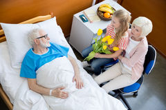 Grandmother and granddaughter visiting patient Royalty Free Stock Photos
