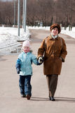 Grandmother with granddaughter on walk Royalty Free Stock Image