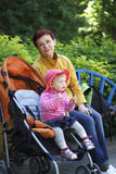 Grandmother and granddaughter walk in the park Royalty Free Stock Photography