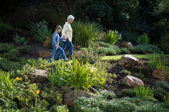 Grandmother and granddaughter walking in the garden Stock Photo