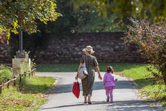 Grandmother and granddaughter walking Stock Images