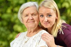 Grandmother and granddaughter. Young woman carefully takes care Stock Photography