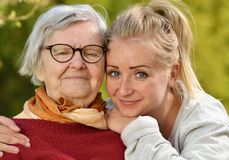 Grandmother and granddaughter. Young women carefully takes care of an older woman Royalty Free Stock Photos