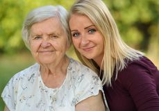Grandmother and granddaughter. Young women carefully takes care of an older woman Royalty Free Stock Images